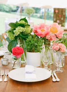 Fresh Pink Green Spring Centerpiece, same idea with fall and wedding colors. white mums, babys breath, greens(maybe herbs) coral roses