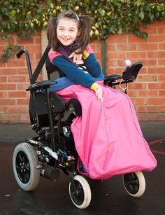 Waterproof Wheelchair Leg Cover  Available in a range of colours  Our Waterproof Outer Leg Cover pulls on over the footplate and fastens around the wheelchair or waist with a simple adjustable strap.  It has a back flap to provide protection to the backs of the lower legs.
