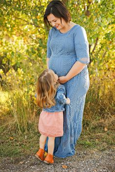Fall Family Photo Session - Autumn - Billings - Norm's Island - Trees - Grass - Kissing Belly - Mom - Mother - Daughter - Kid - Pregnant - Maternity - Blue Dress - Jean Jacket - Pink Dress - Brown Boots - Montana Family Photographer - Sara Nagel Photography Pink Dress, Blue Dresses, Dress With Jean Jacket, Fall Family Photos, Seasons Of The Year, Family Photo Sessions, Brown Boots, Kissing, Family Photographer