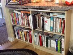 Ikea short shelves under the bar for cook book storage.