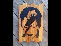 David Bowie Ziggy Stardust Painting on reclaimed wood MTO - 40% of proceeds  will go to The Ronnie James Dio Cancer Fund. (read more below) by MookieWoodArt on Etsy https://www.etsy.com/listing/263627084/david-bowie-ziggy-stardust-painting-on