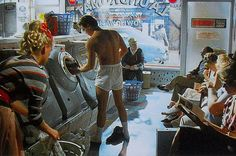 A young Nick Kamen whipping off his Levis to stone wash them in a launderette in 1985.