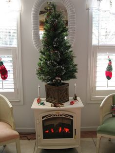 This Clapton Freestanding Stove doubles as a Christmas tree holder- Electric Stove Fireplace, Electric Fireplaces, Christmas Tree Holder, Christmas Time, Xmas, Stove Heater, Stoves, Rustic Charm, Living Rooms