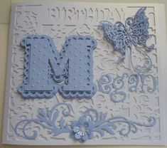 Scalloped Layered Letter Alphabet on Craftsuprint created by Anna Stretton - Love these Scalloped Alpha's, as they can be used for so many different occasions.  I've cut out the Letter M in Lilac and layered together with foam pads.  The top layer has been run through an embossing folder.I've used the card base from cup293432_596 and die cut some smaller letters in the same card to spell out my Daughters name. Added a die cut Butterfly, a flower and flourishes and some small faux pearls.
