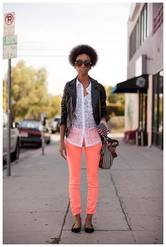 neon pants, white top and black leather jacket