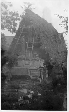 Crews working hard to camouflage their Tiger 1 while serving on the Eastern Front