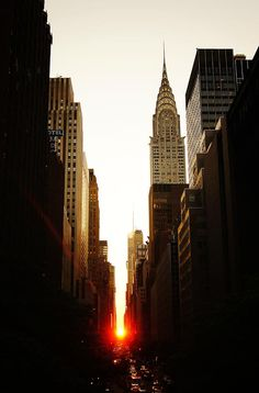Manhattanhenge Sunset And The Chrysler Building - This is a view of the sun setting perfectly aligned with the Manhattan east-west grid looking down 42nd St. in midtown. This occurrence happens twice a year.