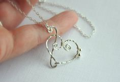 Treble Clef and Bass Clef Heart Pendant.  Very clever design