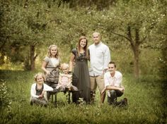 Family Portrait Pose Ideas | Family pose - i like the chair with a child on it. ( i might need a ...