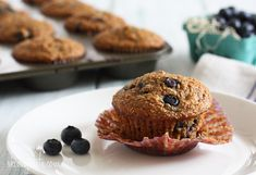 Honey Coconut Blueberry Bran Muffins Recipe Breakfast and Brunch, Breads with wheat bran, whole wheat flour, sweetened coconut flakes, chopped walnuts, baking powder, baking soda, unsweetened vanilla almond milk, honey, vanilla, unsweetened applesauce, coconut oil, large eggs, blueberries