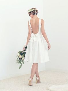 Simple and modern short wedding dress with elegant open back, pockets, and built-in cups. Handcrafted in our Brooklyn atelier with much love and care.