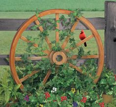 Wagon Wheel Woodworking Plan They look like the real antiques but you make them from plywood for a fraction of the cost! Wagon Wheel Garden, Wooden Wheelbarrow, Winfield Collection, Old Wagons, Rustic Gardens, Outdoor Projects, Garden Projects, Wood Projects, Yard Art