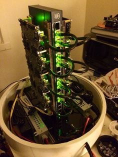 The parallella project is a Cray-1 inspired design which allows the combining of 10 computers (146 processors) into a relatively small package yielding about 208 GFlops peak (just from the parallella boards) at about 100-120 Watts. By Brian Guarraci