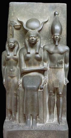 """The Triad of Menkaure"""": Menkaure, Het-Hert (seated), and Nome Goddess, the Valley Temple of the King at Giza, Old Kingdom (4th Dynasty), now in the Boston Museum of Fine Arts. Photo from Schultz and Seidel's Egypt: World of the Pharoahs, p. 330."""