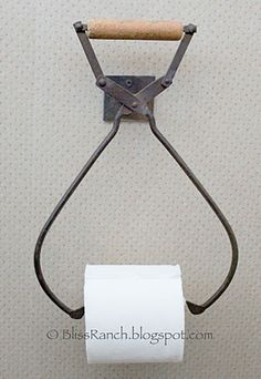 Here's an interesting idea....Vintage Ice- Tong toilet paper holder!