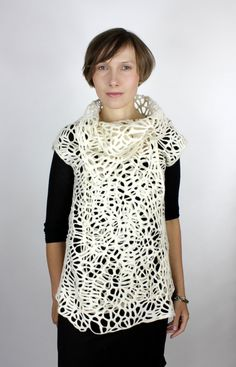 love the beautiful felt scarves and clothing by this Irish artist FeltFieltroFilc on etsy