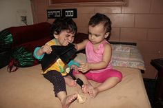 My Grand Daughters Nerjis and Zaira Fight For My Wallet by firoze shakir photographerno1, via Flickr
