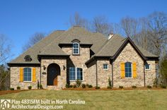 Architectural Designs House Plan 48315FM on a walkout basement in reverse layout in North Carolina. We love how the back of the home takes advantage of his rear-sloping lot.  Ready when you are. Where do YOU want to build?  Specs-at-a-glance   4 beds   3.5 baths   2,900 sq. ft.
