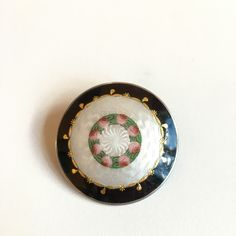 Gustav Gaudernack design for own workshop. Silver gilt guilloché enamel brooch with painted rose motif. 1910-1914