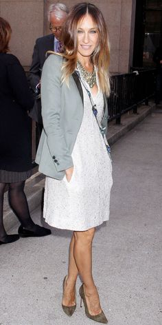 Sarah Jessica Parker in a white L'Agence shift that she styled with a bib necklace, anaconda Elisabeth Weinstock crossbody and pointy-toe Manolo Blahnik heels.