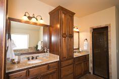 Beacon Master Bathroom: linen cabinet built into vanity, Giallo Ornamental granite, Walnut Travertine accents, Oil Rubbed Bronze details