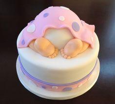 Baby bottom pink baby shower cake.