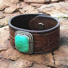 This leather cuff bracelet was created from a reconditioned, vintage leather belt full of well-worn character. We have repurposed an old pawn