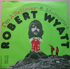 """ROBERT WYATT """"I'm a Believer"""" b/w """"Memories"""" 1974 Virgin. His MONKEES/NEIL DIAMOND cover b/w a song originally done by THE WILDE FLOWERS in early '66 & written by SOFT MACHINE (Post KEVIN AYERS) bass player HUGH HOPPER. WYATT had also done a version w/ DAEVID ALLEN in 1971 on """"Banana Moon"""" album. This was from sessions right after his accident & """"Rock Bottom"""" lp.. He's still recording & worked w/ everyone from SYD BARRETT to THE RAINCOATS."""