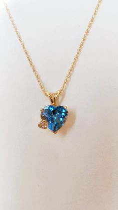 This lovely pendant is as magnificent as it is charming with 3.05 carats of Topaz the pendant is in 14K yellow gold. The pendant also has a V-shaped bail and three very small diamonds in another heart on the side of the Topaz gemstone. Make this the perfect gift for a Birthday or Valentine's Day ! $185