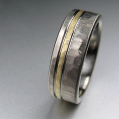 Men's Hammered Gold Pinstripe Wedding Band in Titanium made by Spexton.com