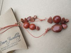 A personal favourite from my Etsy shop https://www.etsy.com/uk/listing/247266826/gold-copper-lariat-goldstone-ynecklace