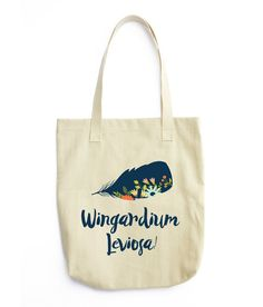 Wingardium Leviosa!  Our Quote Tote features the spell from Harry Potter made famous by Hermione Granger in our very own original graphic design perfect for the Potterhead in your life. The feather print is available in four colors: blue, green, pink and multicolor, please select from the drop down menu. It is digitally printed on canvas tote bag in 100% bull denim woven cotton construction. The tote measures 14 3/8 x 14 (36.5cm x 35.6cm) with dual handles. We use American Apparel canvas…