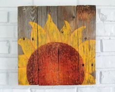 Sunflowers symbolize adoration, loyalty and longevity. Made of reclaimed fence wood, this rustic sign features a charming single sunflower by VintageSignDesigns. Rustic Signs, Rustic Barn, Barn Wood, Painted Garden Rocks, Sunflower Wall Decor, Country Wall Decor, Farm Fence, Happy Flowers, Used Vinyl