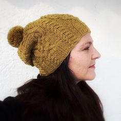 Favorki is a slouchy hat with four cable panels. It is worked
