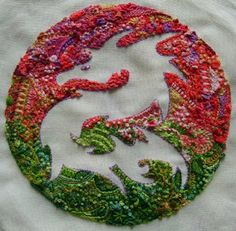 Assisi dragon embroidery. Nice use of negative space.