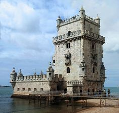 """""""Torre de Belem"""" in Lisbon, Portugal. Built as a defensive tower at near the River Tagus (Rio Teijo) but soon they discovered a better use for it as a prison by chaining prisoners in the lower part which would fill with water when the tide came in.  Yeah...not nice."""