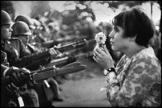 An American young girl, Jan Rose Kasmir, confronts the American National Guard outside the Pentagon during the 1967 anti-Vietnam march. This march helped to turn public opinion against the US war in Vietnam. Washington, D.C., USA, 1967. © Marc Riboud / Magnum Photos