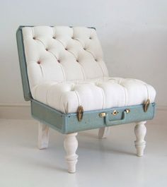 "Tufted slipper chair using a vintage suitcase as ""the bones"""