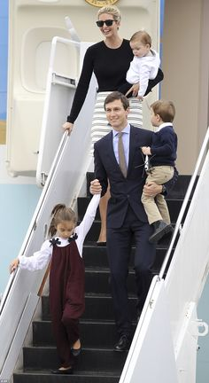 Jared Kushner walks down the stairs of Air Force One with Arabella Kushner, left, and Joseph Kushner, right, as his wife Ivanka Trump carries Theodore Kushner
