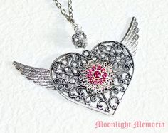 Silver Winged Heart Necklace with Pink Swarovski Crystals - Inspired by Crisis Moon Compact from Sailor Moon. $55