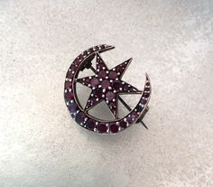 A personal favorite from my Etsy shop https://www.etsy.com/uk/listing/399148279/antique-victorian-garnet-moon-star