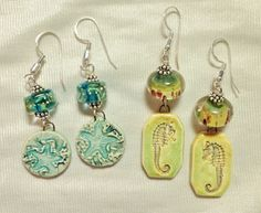 SlinginMud porcelain charms with lampwork beads and sterling silver.
