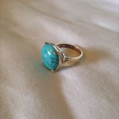 Beautiful turquoise stone ring Size 7 1/2 Elegant style. A turquoise cabochon gives this ring a chic look. Wear this silver-plated ring with new drop earrings to top off any ensemble.