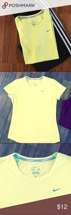 Nike Dri-Fit Running Tee Light material won't weigh you down.  Dri-Fit to keep you dry.  Nike Neon yellow Running Tee.  Size M.  Hardly worn, very good condition!  The tag that they put down inside the shirt by your belly is removed because I thought it was a little scratchy.  If you like running, you will love this shirt!!  Make me an offer I can't refuse! Nike Tops Tees - Short Sleeve