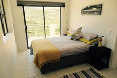 The Master Bedroom has a double bed and sliding doors that open onto the balcony Double Beds, Being A Landlord, Sliding Doors, Cosy, Balcony, Master Bedroom, Living Room, Nature, Furniture