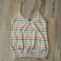 Hurley tank top, multi coloured stripes Perfect for summer! Hurley tank top with elastic roushing at bottom. Cookies stripes to matches anything. Fabulous condition. Comes from super clean and smoke free home. Hurley Tops Tank Tops