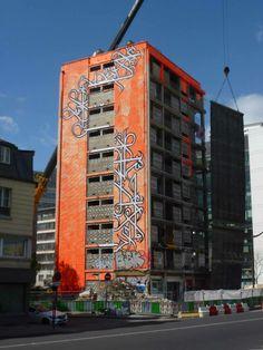 "Street art   Calligraffiti [Arabic calligraphy + graffiti] mural ""Demolish the Tower"" (Paris 13ème, France) by eL Seed"