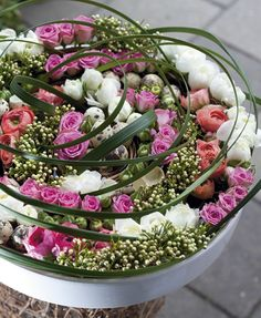 Roses, buttercups and waxflowers (in button) form together a spiral shape - a nice symbol for hope and new life - Photo: Bloem en Blad Art Floral, Floral Design, Beautiful Flower Arrangements, Floral Arrangements, Flower Centerpieces, Flower Decorations, Fresh Flowers, Beautiful Flowers, Spiral Shape