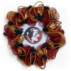"Florida State Seminoles Handmade Wreath  This 24"" wreath is a ""must have"" decoration for football season. A combination of deco mesh, decorative tubing and ribbon, fashions a stunning weather resistant product. The wreath is perfect for display on doors, windows, mantels, and many other areas inside or outside your home."