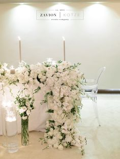 Brides Table with white roses, white orchids and champagne table cloths. Candlelight and flowing flower runners, flower draping. Bride, wedding flowers, Royal wedding, Lux wedding, Luxe Wedding, classic wedding.Photographer Rensche Mari